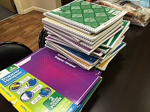 School supplies were being prepared for a giveaway program at the Lee Barta Community Center. [Bob Joseph/WNBF News]