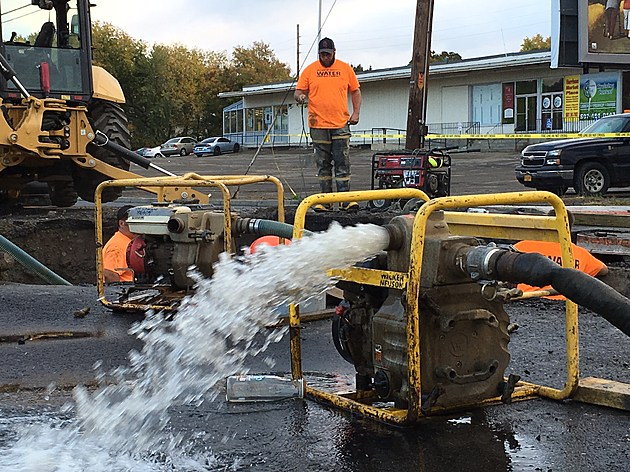 Water was pumped away from a broken line as workers made repairs. [Bob Joseph/WNBF News]