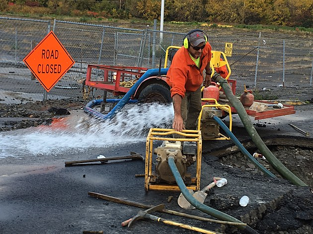 Water was pumped from the site of a broken main on October 19, 2016. [Bob Joseph/WNBF News]