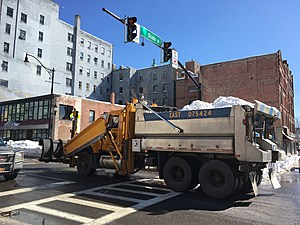A state Department of Transportation truck hauled a load of snow out of downtown Binghamton. (Photo: Bob Joseph/WNBF News)