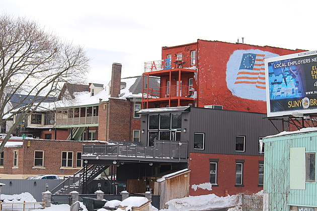 A view of the back side of the frat house from the Court Street bridge. (Photo: Bob Joseph/WNBF News)