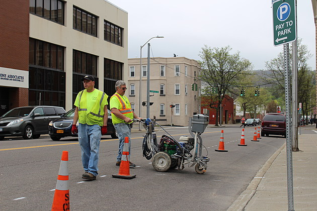 City workers applying fresh paint to designate parking spaces on Exchange Street. (Photo: Bob Joseph/WNBF News)