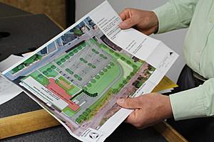 Binghamton University president Harvey Stenger holding a site plan for the future nursing school. (Photo: Bob Joseph/WNBF News)