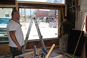 Gino Guler, left, observing renovations at a future Binghamton pizza shop. (Photo: Bob Joseph/WNBF News)