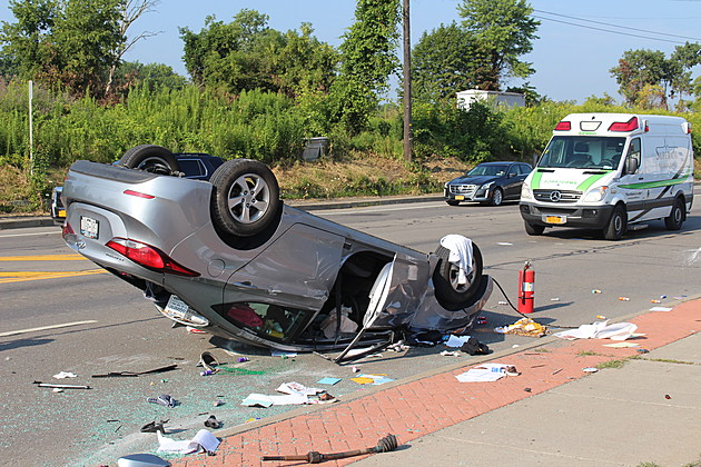 A car landed on its roof in a rush-hour crash on Court Street in Binghamton. (Photo: Bob Joseph/WNBF News)