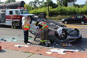 Binghamton firefighters examine the wrecked vehicle. (Photo: Bob Joseph/WNBF News)