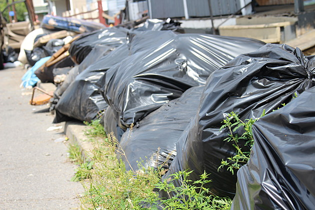 Bags of garbage on a North Side street were at the curb a day before the scheduled collection. (Photo: Bob Joseph/WNBF News)