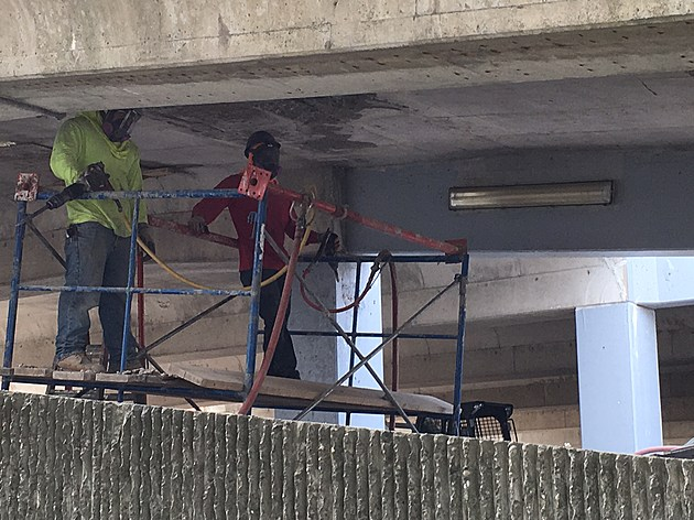 Workers making repairs in the State Street parking garage. (Photo: Bob Joseph/WNBF News)