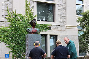 A Binghamton police officer with two Broome County employees at Columbus monument. (Photo: Bob Joseph/WNBF News)