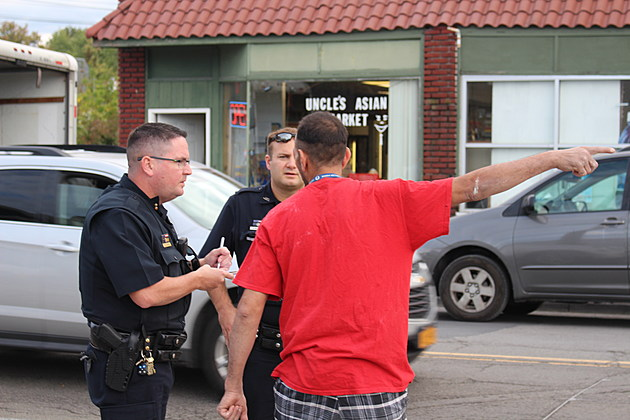 Police officers conducting an interview moments after shots were fired in Johnson City on October 5, 2017. (Photo: Bob Joseph/WNBF News)