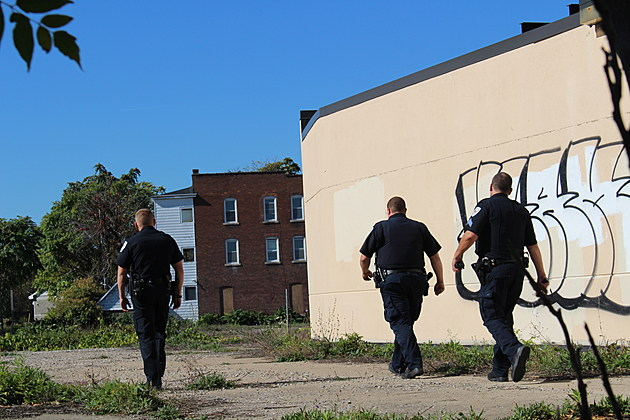 Police officers behind the former DMV office building on Clinton Street shortly after the store robbery. (Photo: Bob Joseph/WNBF News)