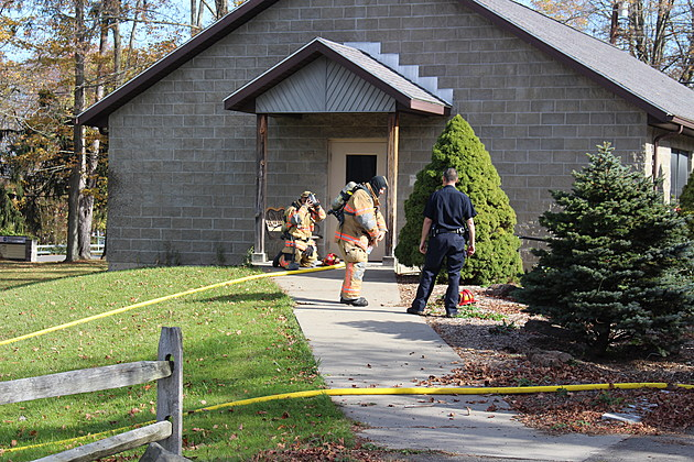 The first firefighters to arrive at the scene gear up to prepare to enter a building at Bridgewater Church on October 21, 2017. (Photo: Bob Joseph/WNBF News)