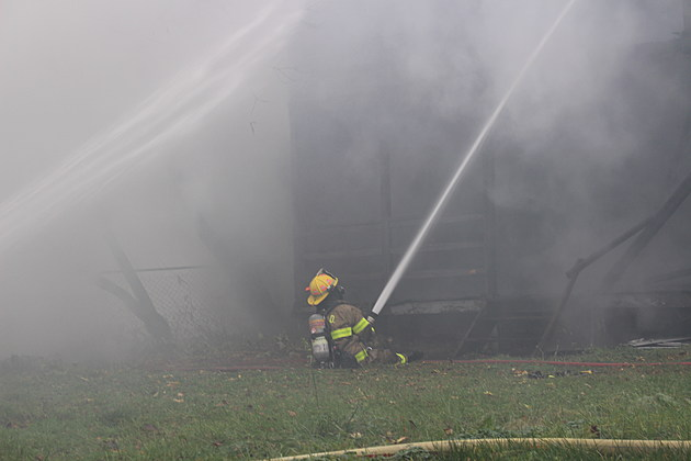 A Binghamton firefighter directs a stream of water from the south side of the Robinson Street structure. (Photo: Bob Joseph/WNBF News)