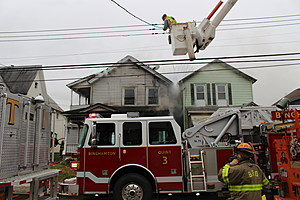 A NYSEG worker disconnecting an electric line near the fire scene on Robinson Street. (Photo: Bob Joseph/WNBF News)